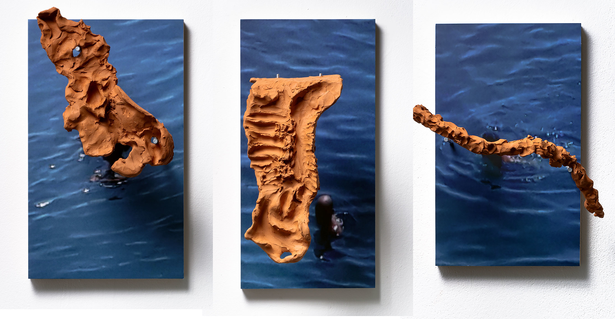Bodies-Made-Of-Water-Series-of-7-sculptures-with-photographs-UV-Print-of-cell-phone-screen-grabs-on-wood-steel-hangers-terra-cotta-ceramics-30-x-60-cm-or-30-x-50-cm-2020-1